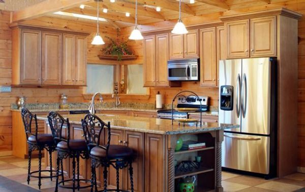 Beautiful-bright-Rustic-design-kitchen-with-wooden-cupboards-with-beautiful-lighting-elegant-bar-stools-refrigerator-and-oven