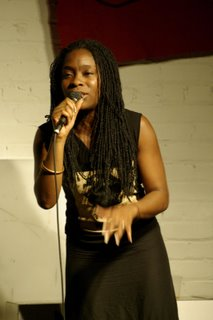 Nigerian-American poet Iyeoka Ivie Okoawo performs for Boston teens
