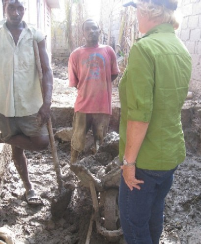 Miriam Frederick with Haiti Flood Victims Months Later Still Buried in the Mud