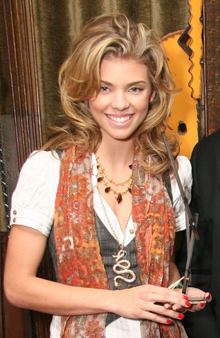 AnnaLynne McCord holding a GG at VIP Gifting Suite