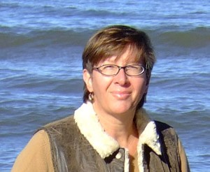 Loreen Niewenhuis on Lake Michigan beach