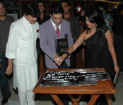L to R Amrit Kiran Singh, Suneet Varma and Sujata Assomull cutting the Cake