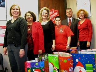 Catch the Holiday Spirits Sponsors deliver gifts to Salvation Army