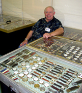 Peter Mellon displays over 2,000 watches, watch chains, knives and lighters in hi