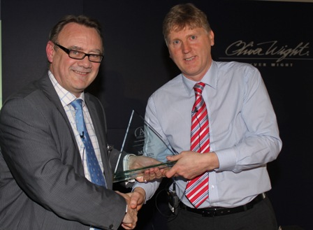 Sales & Operations Manager, David Wragg, receiving the award from David Manning