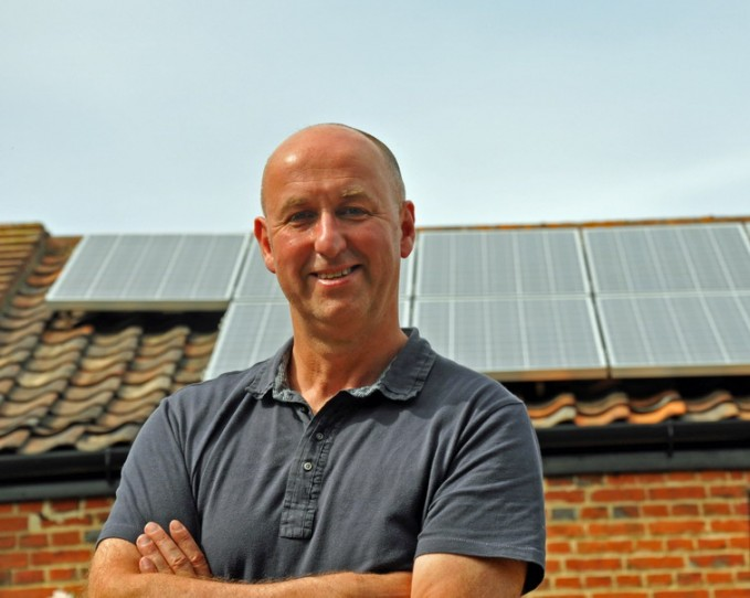 Tim Morgan in front of The Publicity Works' solar panelsz