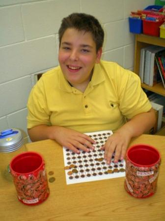A Goodwill L.I.F.E. Academy student counts pennies