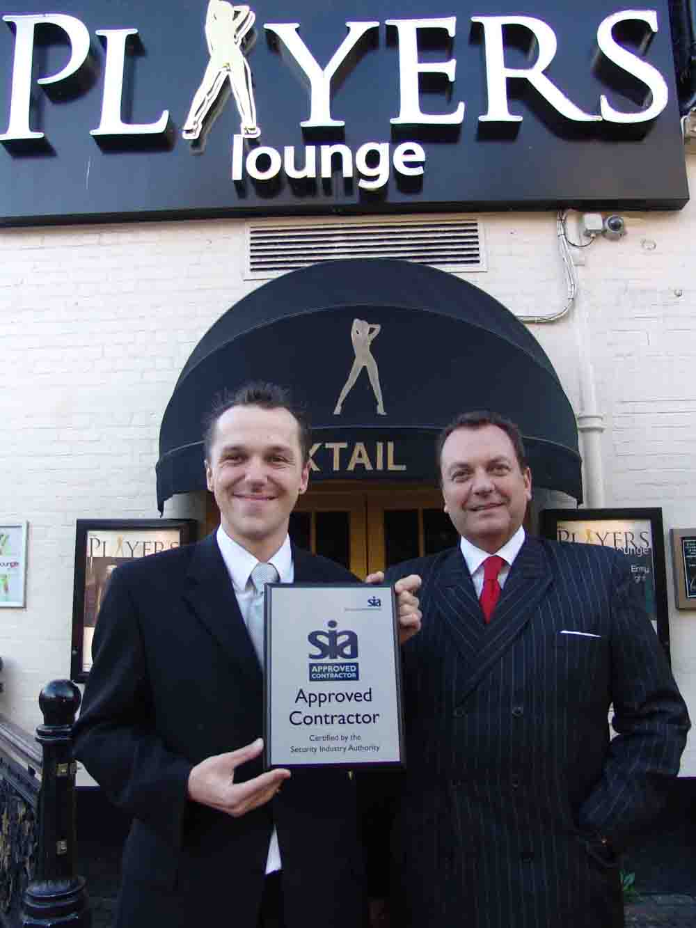 Andrew Shephard of SIA presents Michel Harper with the accreditation - low res