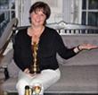 Barb Shadomy holds real Oscar award, London