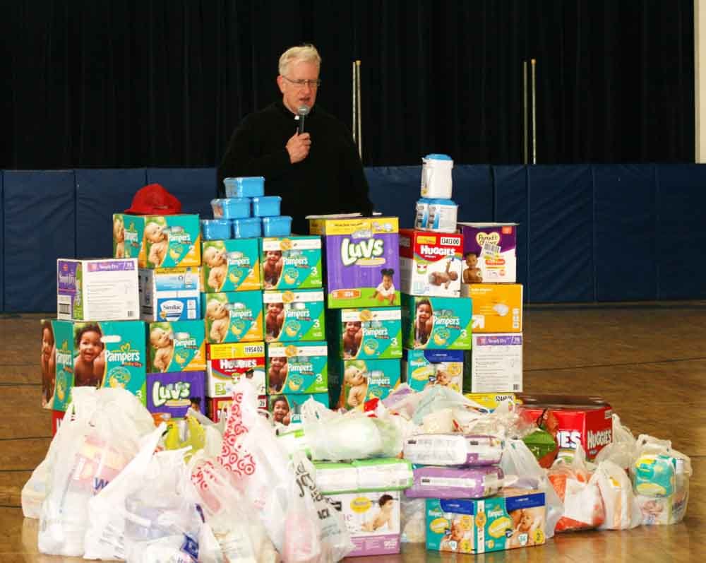 Rev. Shea blessed the collection of baby supplies.