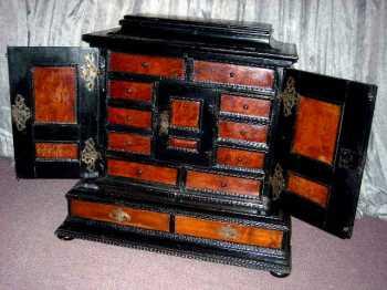 Ebonized and walnut jewelry cabinet