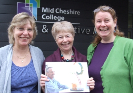 Students Caroline,Maria and Jane with a photo of the late Keith Robinson