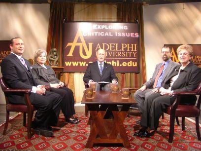 Robert Scott (center) hosts Exploring Critical Issues