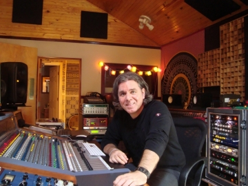 Rogers Masson at the console inside his studio.