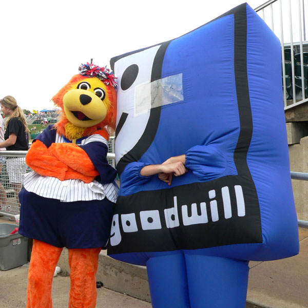 "Miss A-Miracle with Goodwill's Mascot ""Smiley G"""