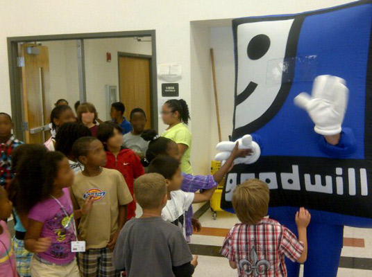 Elementary School Students meet Goodwill's mascot.