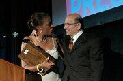 TV anchor presents LA Press Club Award