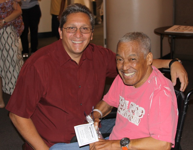 Gustavo Hermidia brings a smile to a resident.