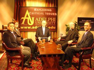 Dr. Scott (C) Hosts Exploring Critical Issues