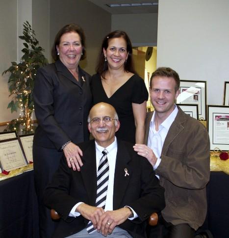 Dr Tariq Malik surrounded by family