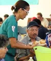 Stanbridge vocational nursing student serves meal