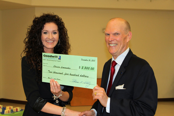 Christa Lemonakis receives her award check