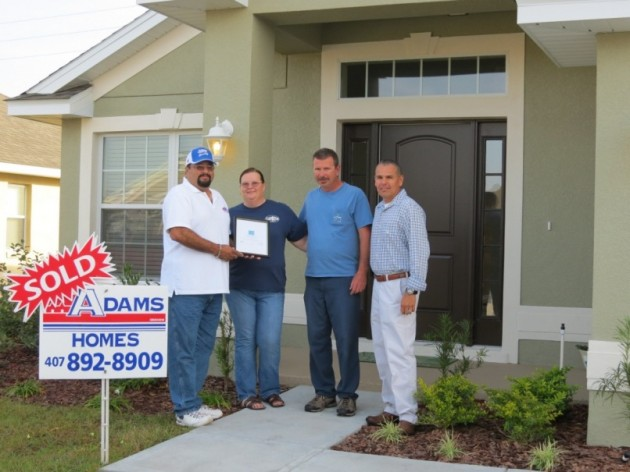 Adams Homes presenting Energy Star certificate