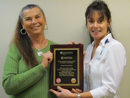 Daytona State College accepts a plaque.