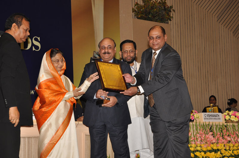 Mr. Sharma receiving award from President Patil