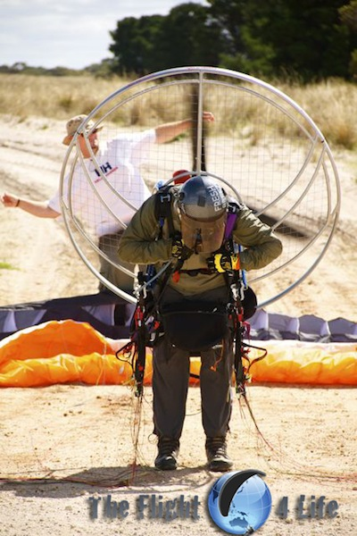 Paramotor pilot preparing to launch