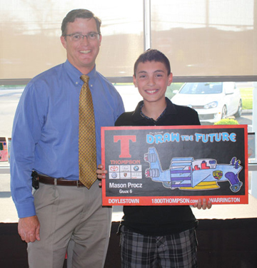 John Thompson, VP of Thompson Organization with Mason Procz, Grand Prize Winner