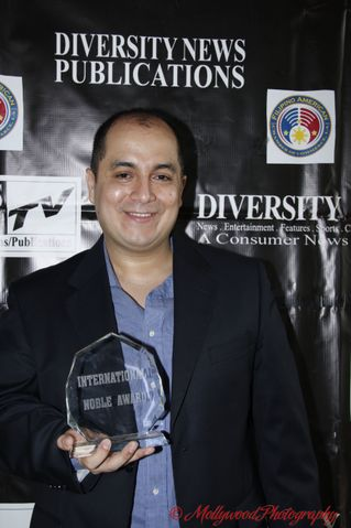 Steven Escobar with Award