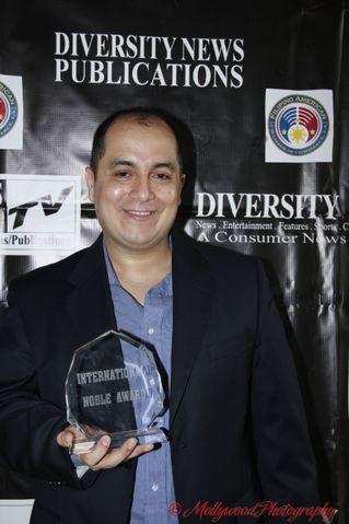 Steven Escobar with Award