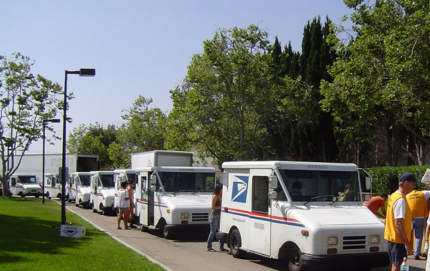 Postal carriers line up during Stamp Out Hunger