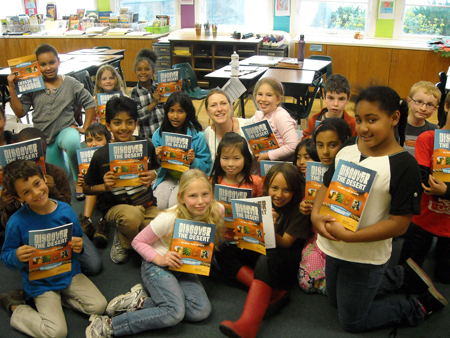 Berkeley 3rd graders & teacher holding their 'Discover the Desert' books
