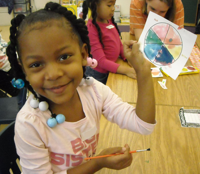 Oakland Kindergarten student during a lesson on colors, prisms, & chromatography