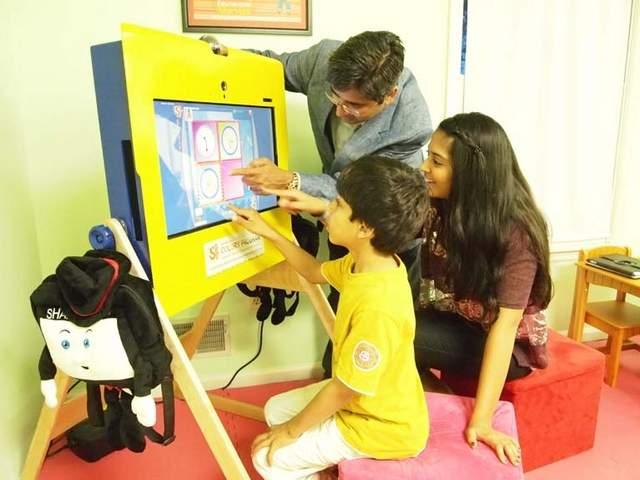 Nish Parikh at kiosk with Sahil Patel, 6 and Nishali Parikh, 14 from Raritan, NJ