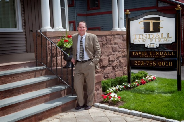 Attorney Tavis Tindall in Front of 64 Holmes Ave Offices in Waterbury, Conn.
