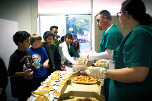 Vocational Nursing students serve lunch to the children of Project Hope Alliance