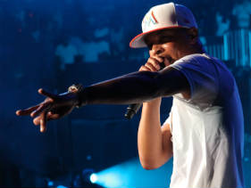 "T.I., a.k.a ""King of the South"", pictured onstage at a recent concert in Atlanta"