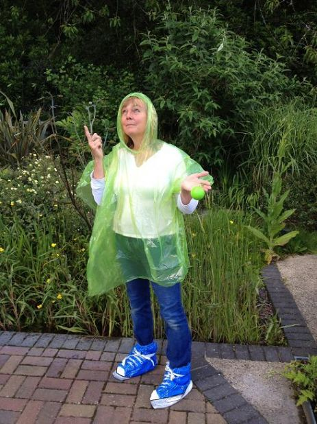Little Paddock co-owner Sue Jones models the free ponchos and boots!
