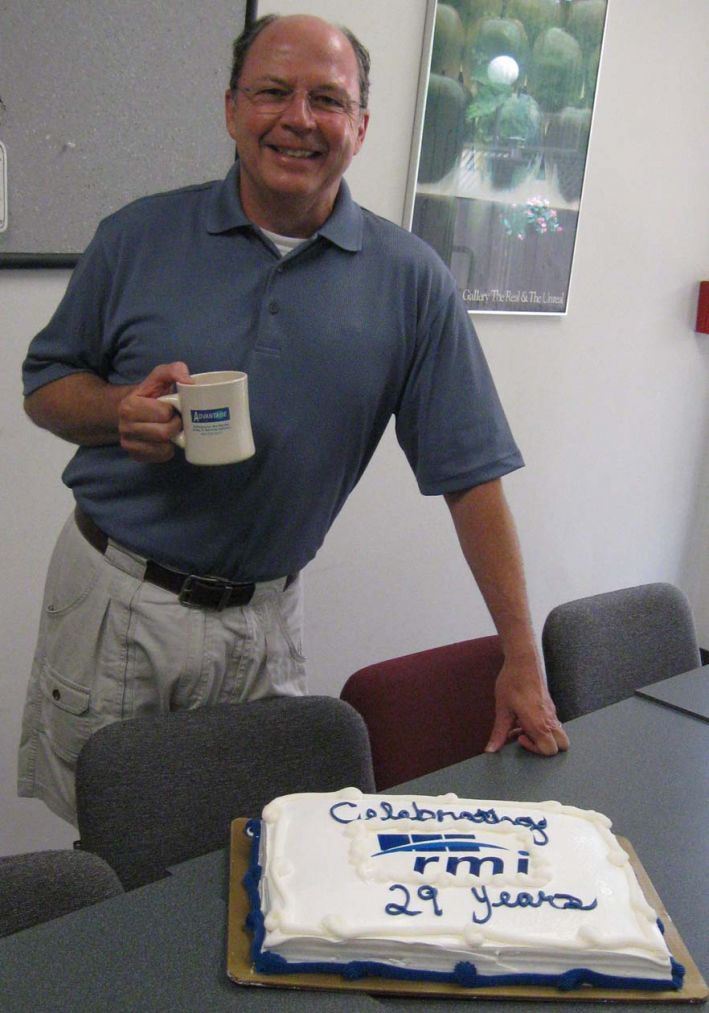 Chapdelaine cuts the cake at RMI's corporate meeting.