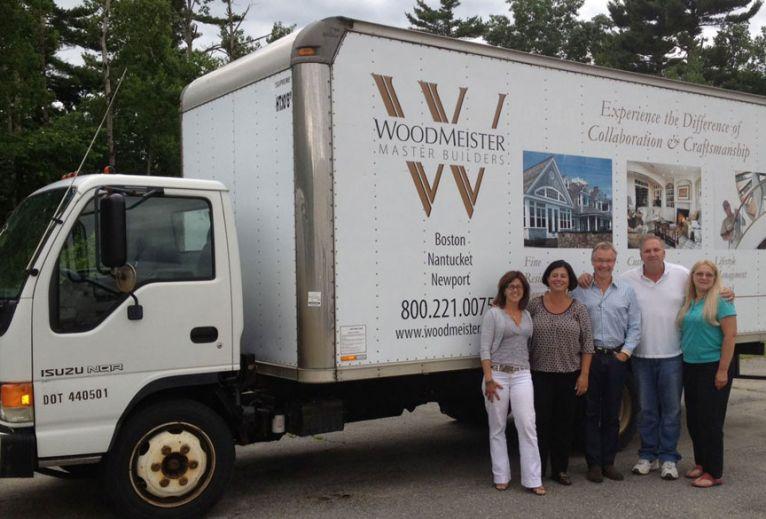 Woodmeister presents box truck to Len and Cherylann Gengel of Be Like Brit