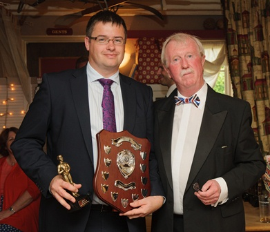 (L to R) Marc Taylor collects the award from Gordon Storey