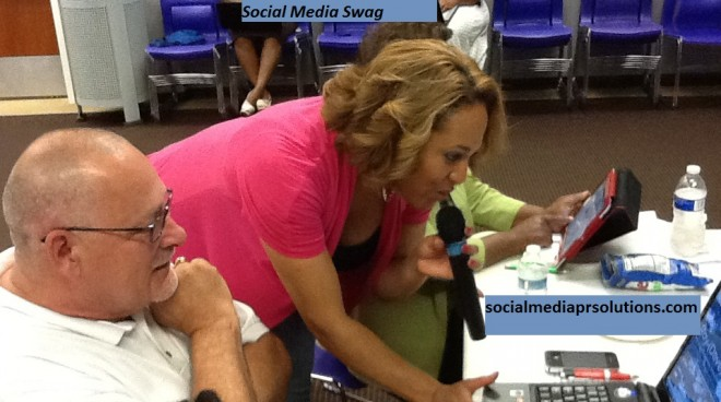Pam Perry giving hands-on instruction at social media day event