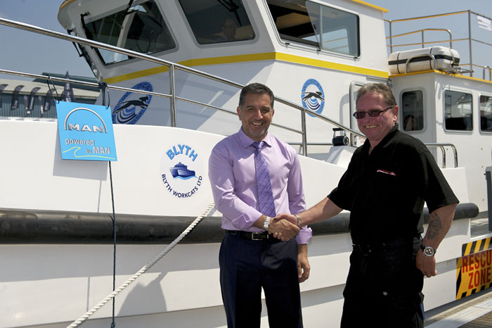 Dr Omar Namor (left) accepts Wildcat 3 from Ray Chuter of  Blyth Workcats