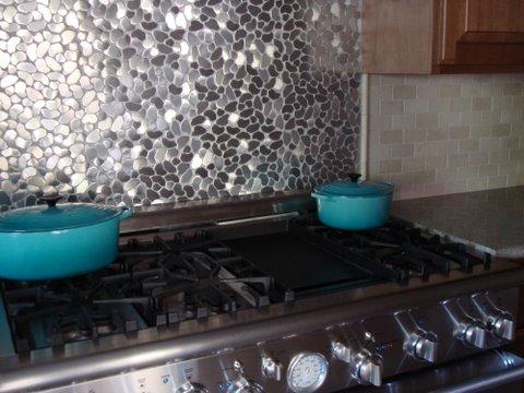 of stainless steel mosaics is abundant in todays kitchen backsplashes