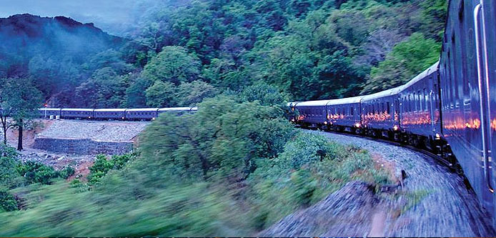 Deccan Odyssey train riding through picturesque Deccan Plateau