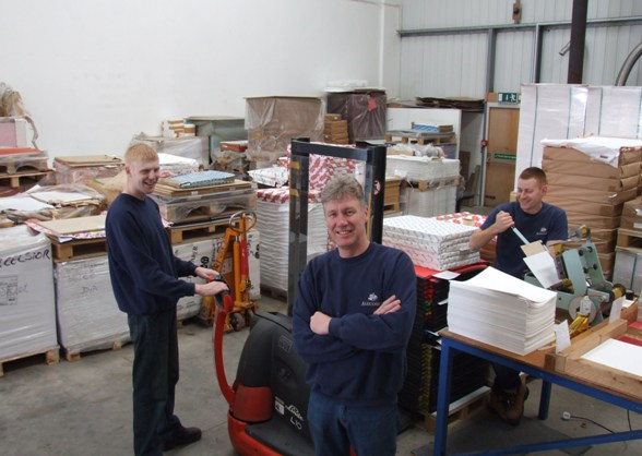 Sandy Cowen (centre)  with book production team