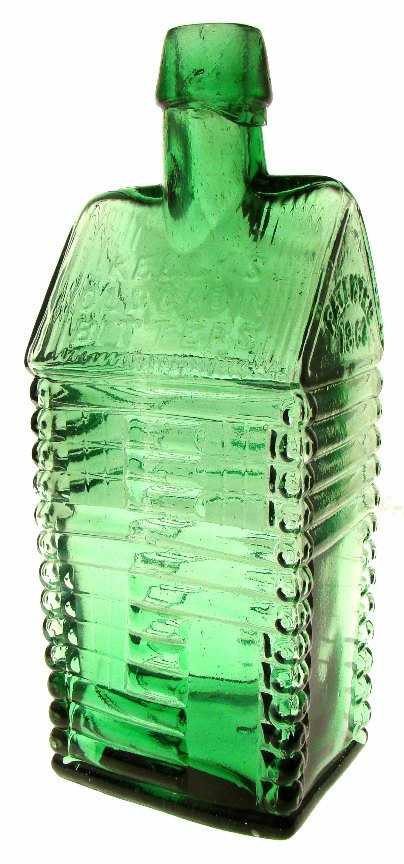 Kellys Old Cabin bitters bottle, green